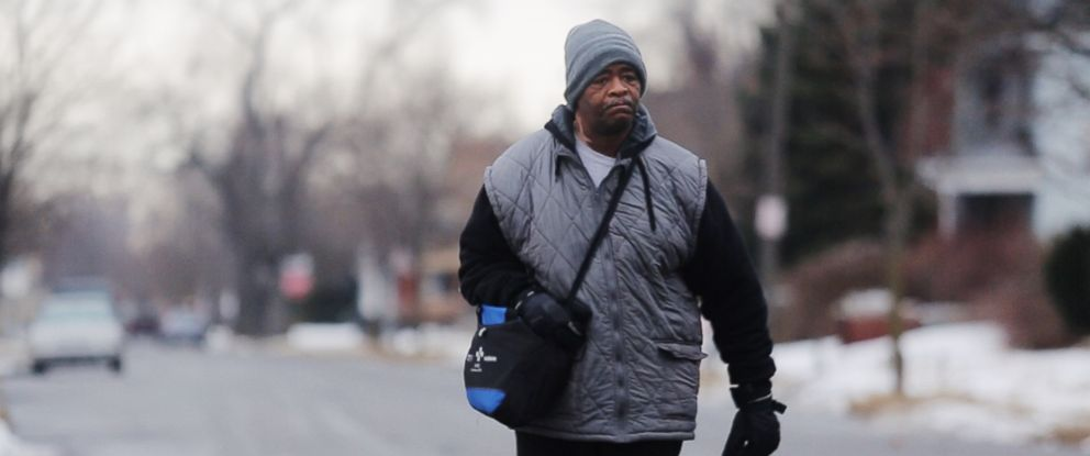 PHOTO: In this Jan. 29, 2015, photo, James Robertson toward Woodward Aveune in Detroit to catch his morning bus to Somerset Collection in Troy before walking to his job at Schain Mold & Engineering in Rochester Hills.