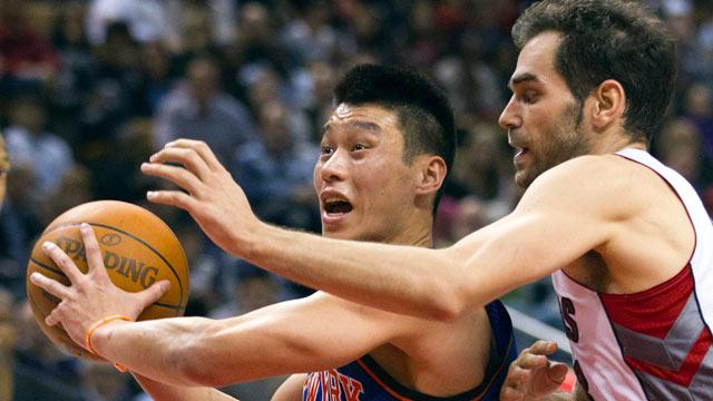 PHOTO: New York Knicks guard Jeremy Lin drives past Toronto Raptors guard Jose Calderon during the second half of an NBA basketball game in Toronto, Feb. 14, 2012.