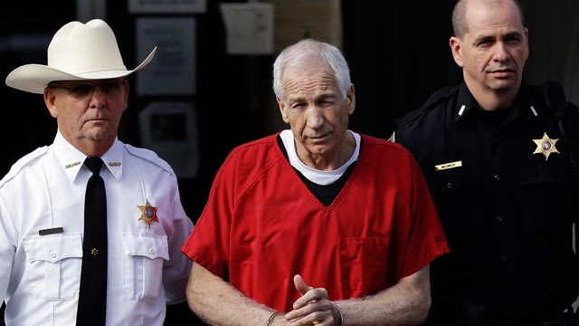PHOTO: Former Penn State University assistant football coach Jerry Sandusky, center, is taken from the Centre County Courthouse after being sentenced in Bellefonte, Pa., Oct. 9, 2012.