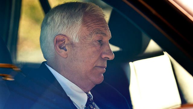 "PHOTO: Gerald ""Jerry"" Sandusky sits in a car as he leaves the office of Center County Magisterial District Judge Leslie A. Dutchcot."