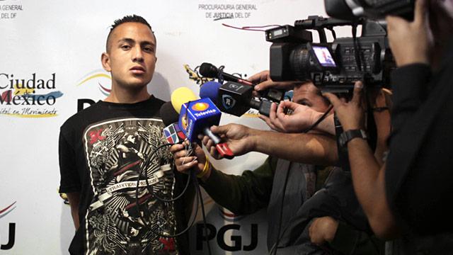PHOTO: Journalists question Jose Manuel Ramirez, arrested in death of US Airways flight attendant