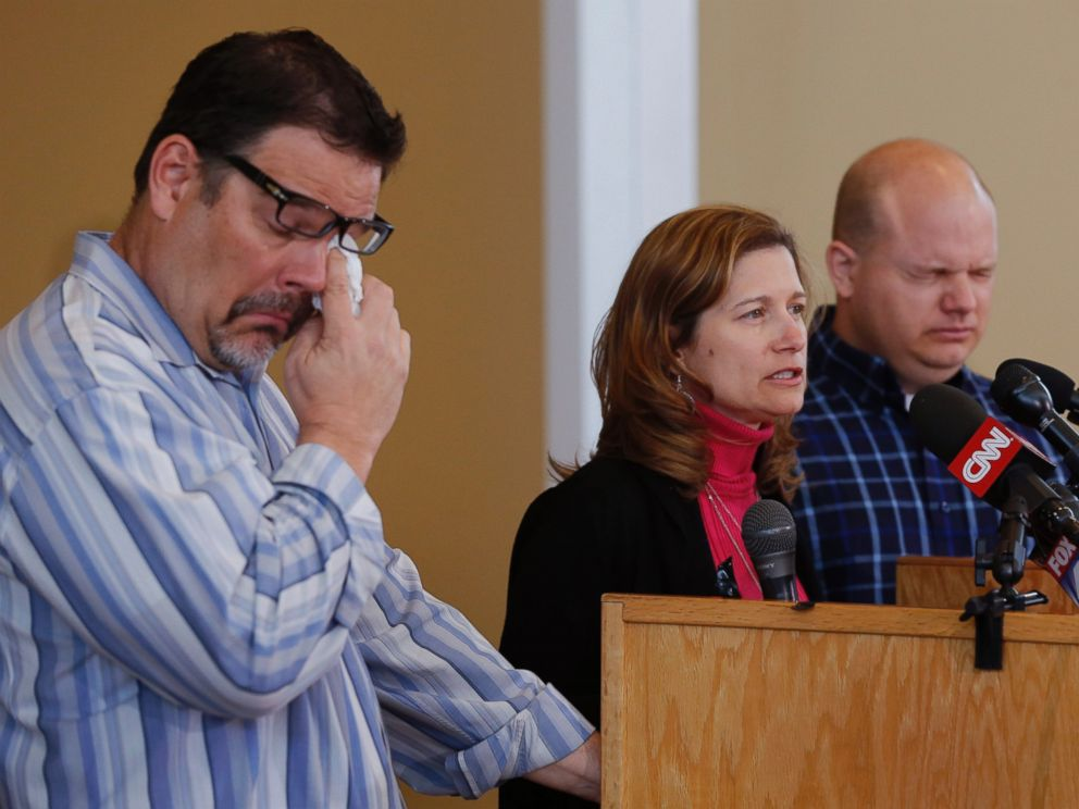 PHOTO: Will Corporon, left, and Tony Corporon, right, fight emotions while Mindy Losen, center, talks about her son and father during a news conference at their church in Leawood, Kan., April 14, 2014.