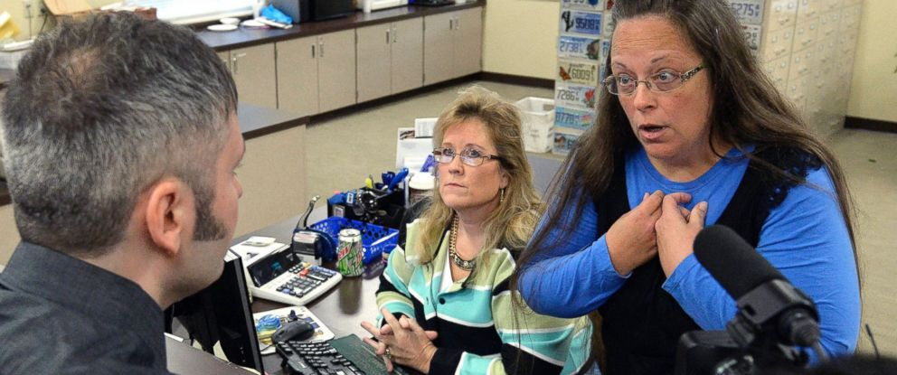 PHOTO: Rowan County Clerk Kim Davis, right, talks with David Moore following her offices refusal to issue marriage licenses at the Rowan County Courthouse in Morehead, Ky., Sept. 1, 2015.