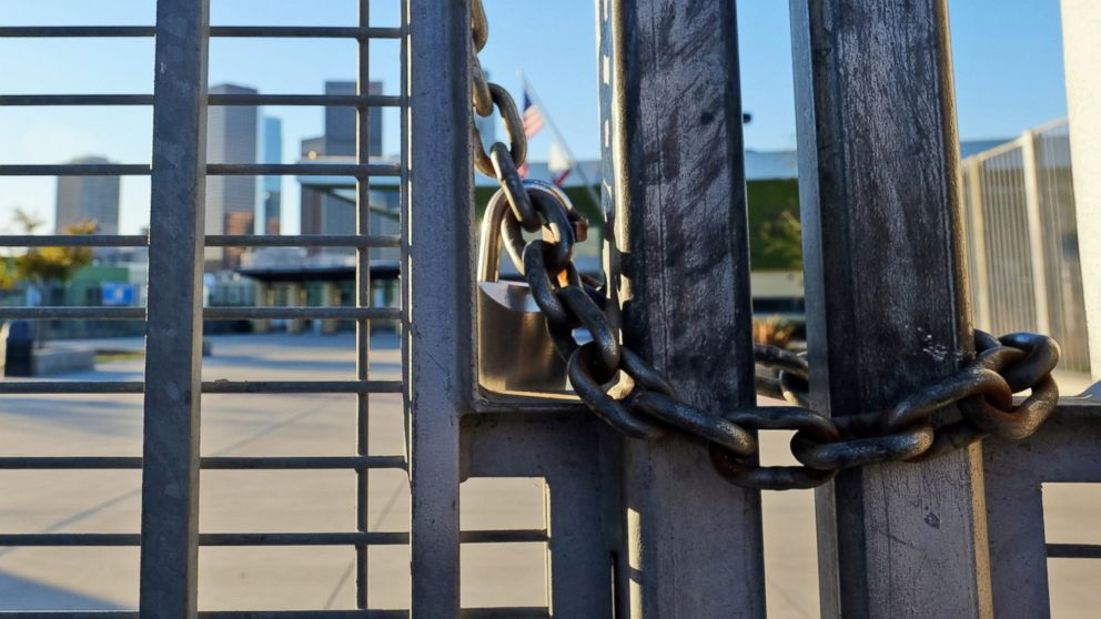 A lock holds the gate shut at Edward Roybal High School in Los Angeles, Dec. 15, 2015.