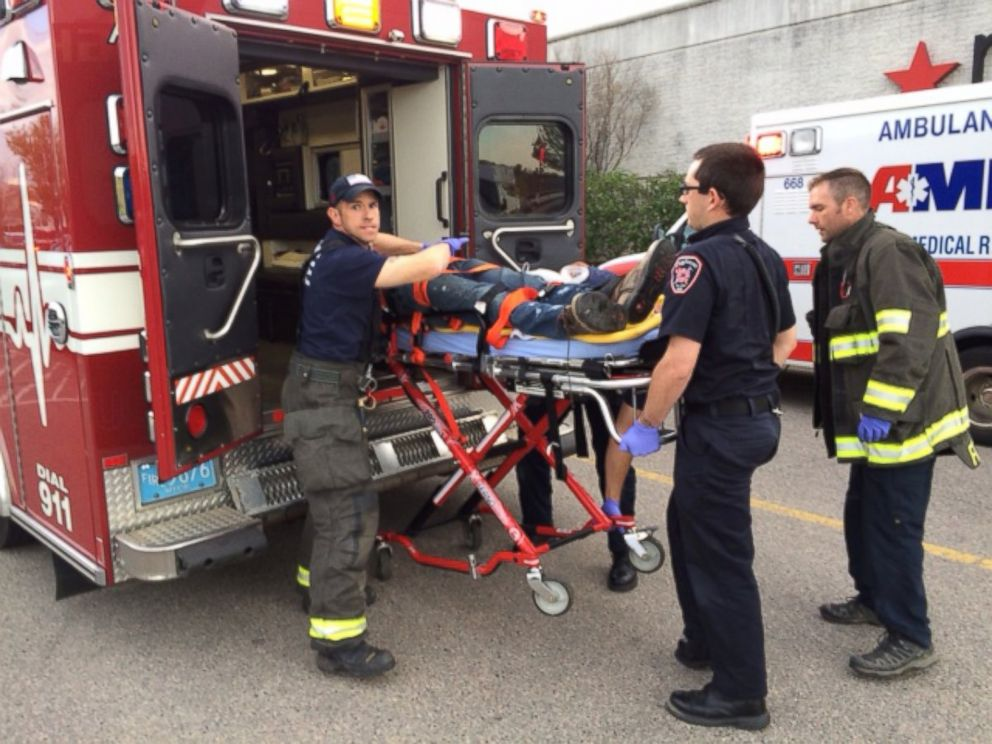 PHOTO: The suspect in a series of stabbings is transported on a gurney into an ambulance by medical personnel at the Silver City Galleria mall in Taunton, Mass., May 10, 2016.