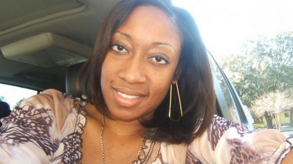 This undated family photo provided by Lincoln B. Alexander shows Marissa Alexander in her car in Tampa, Fla.