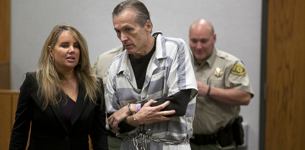 PHOTO: Martin MacNeill speaks to his defense lawyer Susanne Gustin in Fourth District Court in Provo, Utah during a preliminary hearing, Oct. 10, 2012.