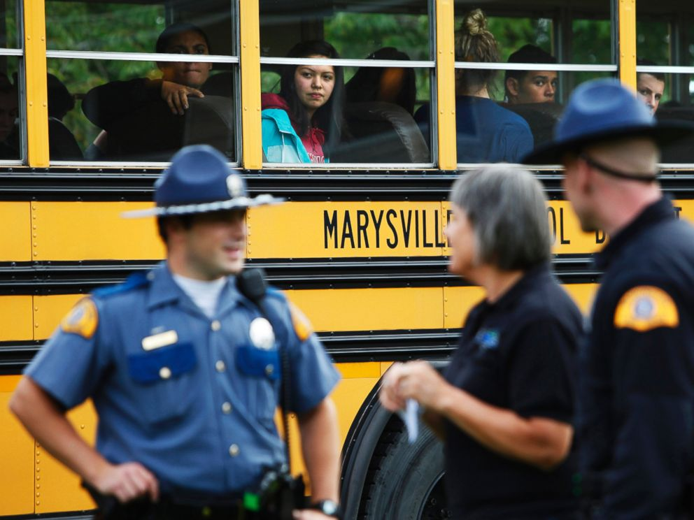 PHOTO: Marysville-Pilchuck students are bussed from the high school to the nearby Shoultes Christian Assembly Church where they were reunited with their families after a school shooting took place, Oct. 24, 2014.