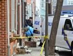 PHOTO: Police remove the body of a woman found burned to death in her basement on the 1700 block of Naudain St. in Center City, Jan. 21, 2013 in Philadelphia.