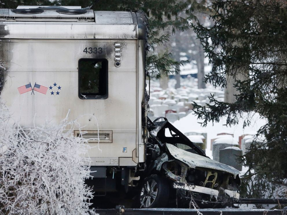 PHOTO: A sports utility vehicle remains crushed and burned at the front of a Metro-North train, on Feb. 4, 2015, in Valhalla, N.Y.