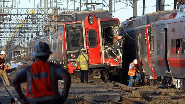 PHOTO: Emergency personnel work at the scene where two Metro North commuter trains collided, Friday, May 17, 2013 near Fairfield, Conn.
