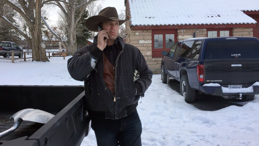 Ryan Bundy talks on the phone at the Malheur National Wildlife Refuge near Burns, Ore., Sunday, Jan. 3, 2016. Bundy is one of the protesters occupying the refuge to object to a prison sentence for local ranchers for burning federal land.