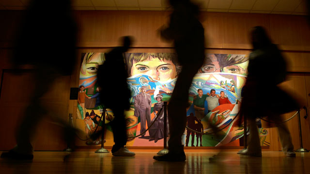 "PHOTO: Students walk past ""The Apotheosis of Youth,"" a mural by Eliseo Art Silva at the Milton Hershey School in Hershey, Pa."