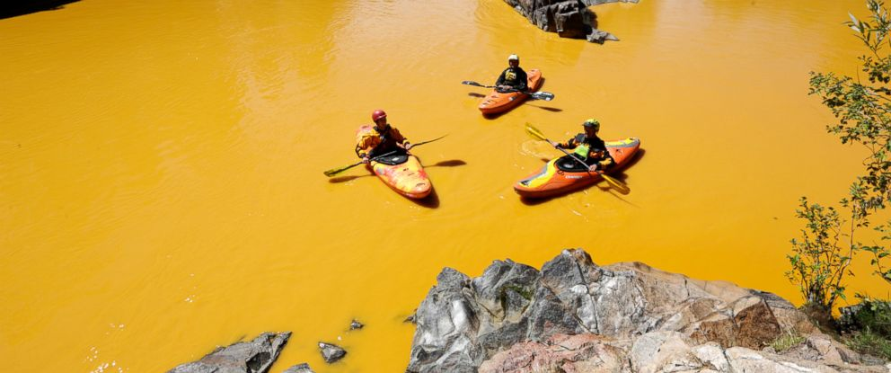 PHOTO: People kayak in the Animas River near Durango, Colo., Aug. 6, 2015, in water colored from a mine waste spill.