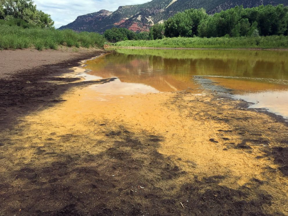 PHOTO: As the Animas River begins to recede it reveals a sludge left behind by the Gold King Mine spillage just north of Durango Colo. on Aug. 7, 2015.