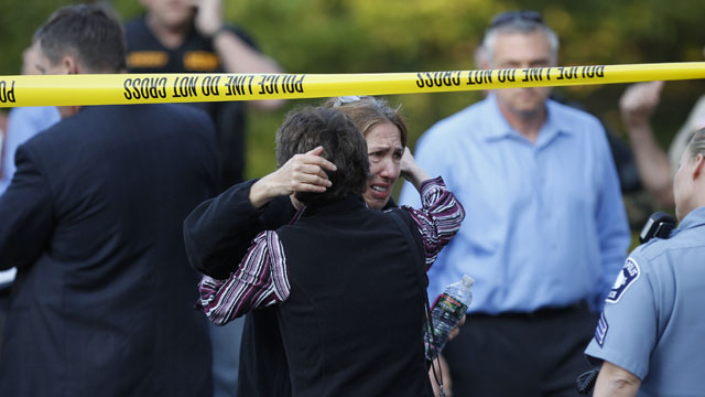 PHOTO:An unidentified woman is consoled at the scene of a shooting that left at least two dead and four others wounded at Accent Signage Systems in Minneapolis, Thursday, Sept. 27, 2012.