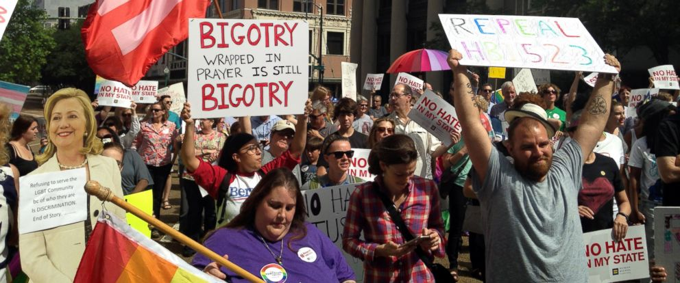 PHOTO: Protesters march in favor of the repeal of a Mississippi law allowing religious groups and some private businesses to deny services to same-sex couples, transgender people and others, May 1, 2016 in Jackson, Miss.