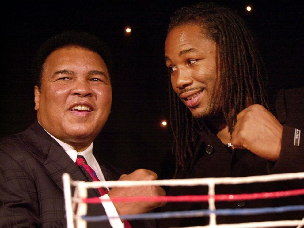 PHOTO: Former Heavyweight Champion Muhammad Ali joins then Heavyweight Champion Lennox Lewis at an event in London, Jan. 15, 2001.