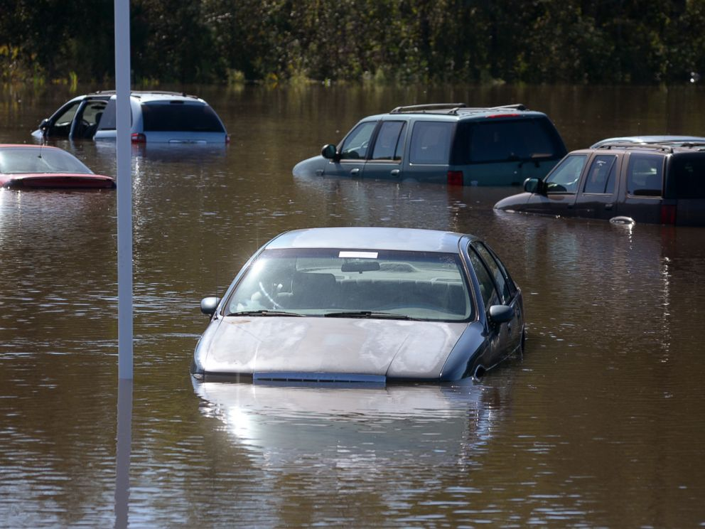 PHOTO: Used cars submerged in lot in flood waters rest along US 70W in Kinston, North Carolina, Oct. 12, 2016, as the Neuse River continues to rise.