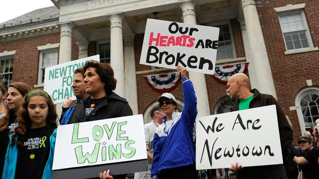 PHOTO: People gather during a ceremony, on the six-month anniversary honoring the 20 children and six adults gunned down at Sandy Hook Elementary school in December, at Edmond Town Hall in Newtown, Conn., June 14, 2013.