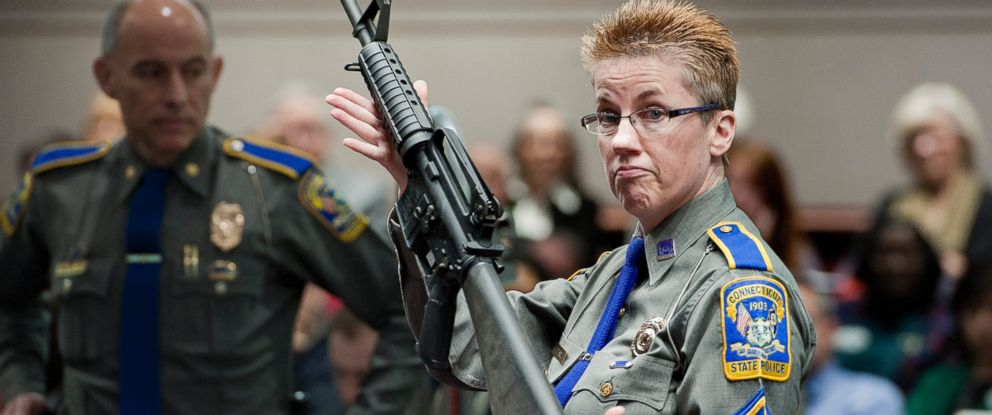 PHOTO: Detective Barbara J. Mattson of the Connecticut State Police holds up a Bushmaster AR-15-style rifle, the same make and model of gun used by Adam Lanza in the Sandy Hook School shooting in Hartford, Conn., Jan. 28, 2013.