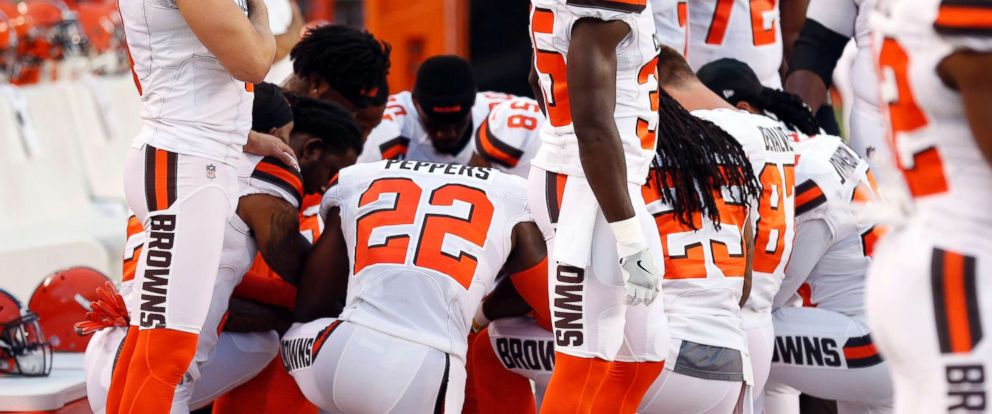 PHOTO: Members of the Cleveland Browns kneeling during the national anthem before an NFL preseason football game between the New York Giants and the Cleveland Browns in Cleveland.