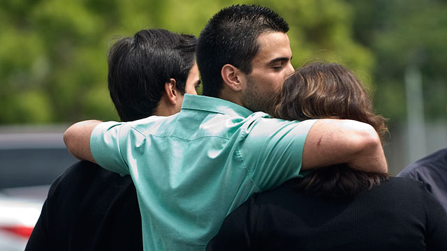 PHOTO: Andres Cendoya, from left, his brother Nicolas Cendoya and their mom head to their Costa Mesa home after Nicholas was released from Mission Hospital in Mission Viejo, Calif., on April 7, 2013 after he and friend Kyndall Jack were lost while hiking