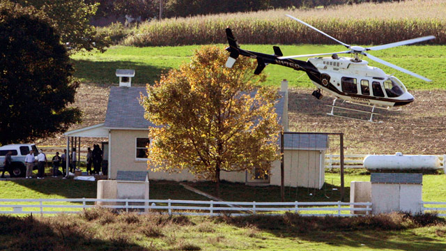 PHOTO: A helicopter takes off from the West Nickel Mines Amish School, in which a gunman killed five girls and injured five more, in Nickel Mines, Pa., Oct. 2, 2006.