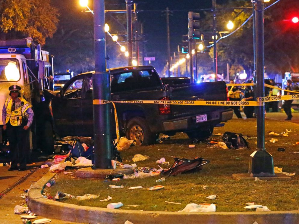 PHOTO: Police stand next to a pickup truck that slammed into a crowd and other vehicles, causing multiple injuries, coming to a stop against a dump truck, during the Krewe of Endymion parade in New Orleans, Saturday, Feb. 25, 2017.