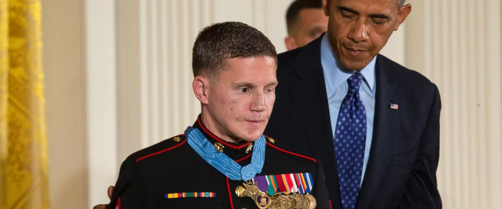 "PHOTO: President Barack Obama reaches out to retired Marine Cpl. William ""Kyle"" Carpenter, after awarding him the Medal of Honor for conspicuous gallantry, June 19, 2014, during a ceremony in the East Room of the White House in Washington."
