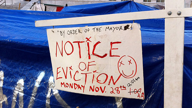 PHOTO: An eviction notice sign posted at the Occupy LA encampment on the grounds of Los Angeles City Hall.