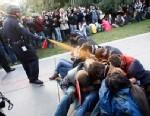 PHOTO: University of California, Davis Police Lt. John Pike uses pepper spray to move Occupy UC Davis protesters