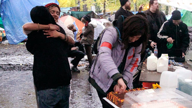 PHOTO: Protesters celebrate winning the battle to stay in the Occupy Portland Camp with hugs, cake and milk in Portland, Ore., Nov. 13, 2011.