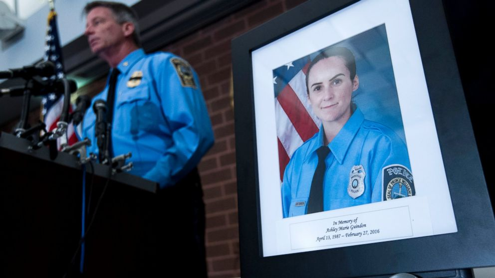 Prince William County Police Chief Stephan Hudson speaks during a news conference next to a picture of Ashley Guindon at Western District Station, in Manassas, Va., Feb. 28, 2016, about a fatal shooting Saturday evening.