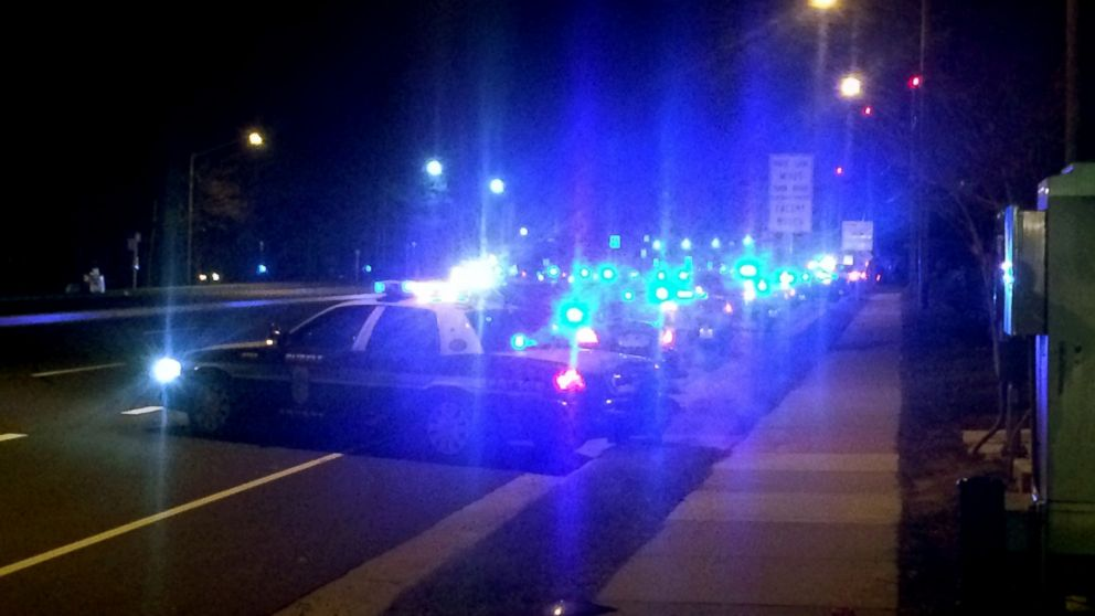 More than 100 patrol cars line the roads outside Inova Fairfax Hospital early Sunday morning, Feb. 29, 2016, to stand vigil and provide escort to the medical examiner for the body of slain Prince William County police officer Ashley Guindon, who was shot and killed Saturday responding to a domestic violence call.