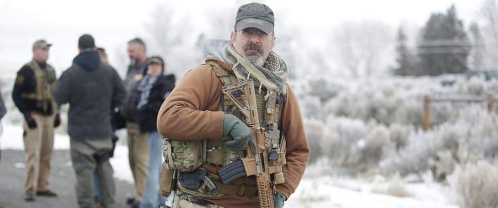 """PHOTO: A man stands guard after members of the """"3% of Idaho"""" group along with several other organizations arrived at the Malheur National Wildlife Refuge near Burns, Ore., on Saturday, Jan. 9, 2016."""