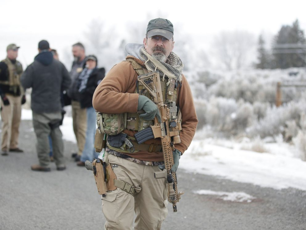 PHOTO: A man stands guard after members of the 3% of Idaho group along with several other organizations arrived at the Malheur National Wildlife Refuge near Burns, Ore., on Saturday, Jan. 9, 2016.