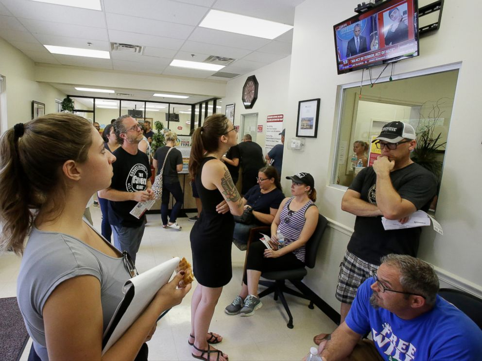 PHOTO: Volunteers waiting at a blood bank watch President Barack Obama deliver remarks on a TV, June 12, 2016, in Orlando, Fla.