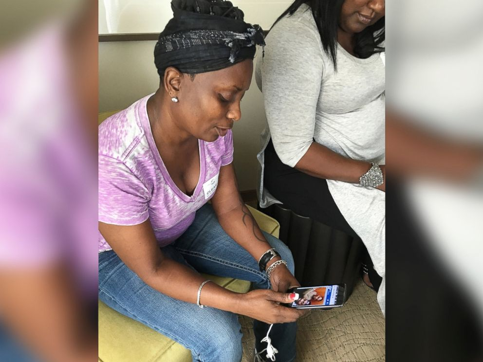PHOTO: Mina Justice speaks to a reporter about texting with her son Eddie Justice who was in a bathroom at Club Pulse, June, 12, 2016, in Orlando.