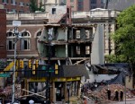 PHOTO: Firefighters view the aftermath of a building collapse, June 6, 2013, in Philadelphia.