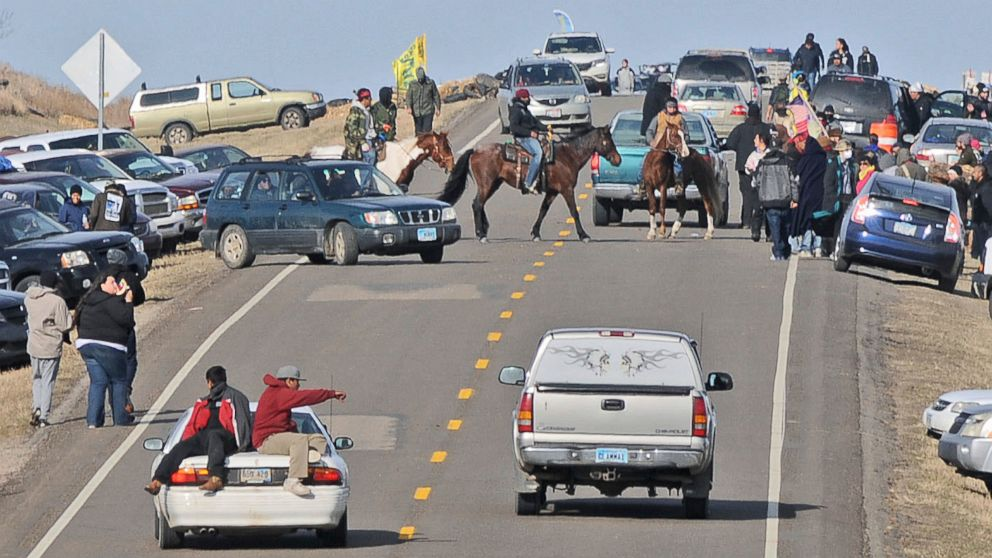 People protesting the Dakota Access Pipeline gather along North Dakota Highway 1806 in Morton County at the site of a new camp that was being put together, Oct. 24, 2016, in Cannonball, North Dakota.