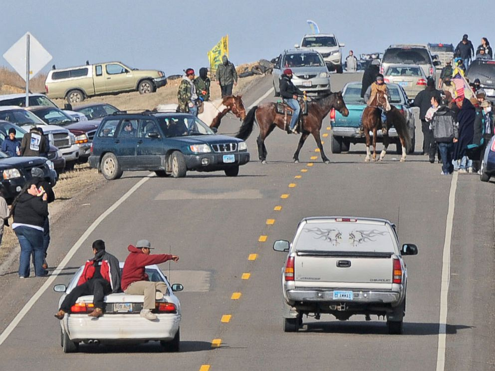 PHOTO: People protesting the Dakota Access Pipeline gather along North Dakota Highway 1806 in Morton County at the site of a new camp that was being put together, Oct. 24, 2016, in Cannonball, North Dakota.