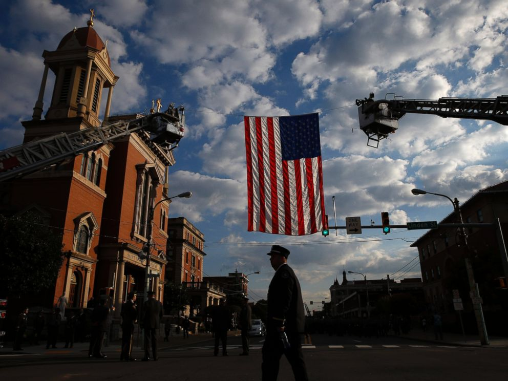 PHOTO: A law enforcement officer arrives for a funeral service for Pennsylvania State Trooper Cpl. Bryon Dickson, Sept. 18, 2014, in Scranton, Pa.