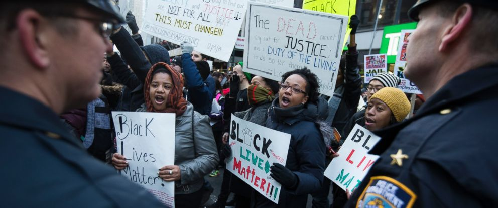 PHOTO: Demonstrators march in New York, Saturday, Dec. 13, 2014, during the Justice for All rally and march.