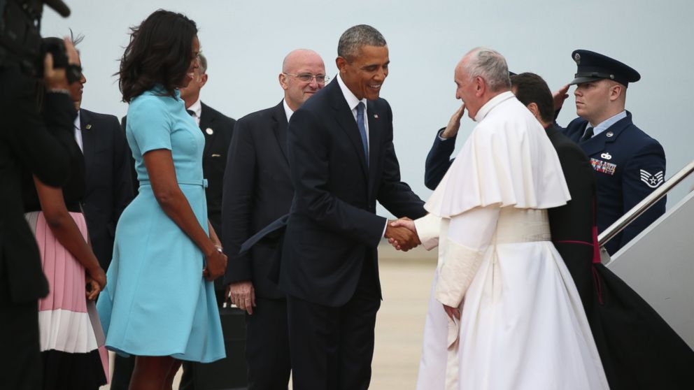 President Barack Obama and first lady Michelle Obama greet Pope Francis upon his arrival at Andrews Air Force Base, Md., Sept. 22, 2015.