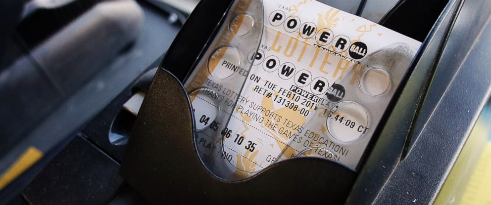 PHOTO: A Powerball ticket sits in the tray dispenser after being printed out for a customer at Fuel City in Dallas, Feb. 10, 2015.