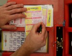 PHOTO: Saturdays jackpot has now swelled to a robust $320 million, and the cash option is worth an estimated 198.3 million. A man picks his Powerball numbers in a convenience store, Nov. 28, 2012.