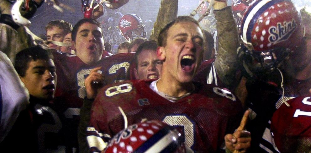 PHOTO: In this Dec. 8, 2001 file photo, Neshaminy quarterback Jason Waiter, center, celebrates with teammates after their 21-7 victory over Woodland Hills to claim the Class AAAA state title in Hershey, Pa.