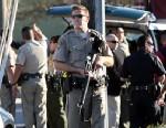 PHOTO: A California Highway Patrol officer carries his rifle near the shooting scene in Santa Cruz, Calif., where two Santa Cruz Police detectives were shot and killed, Feb. 26, 2013.