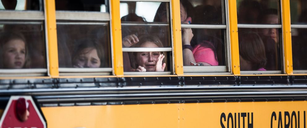 PHOTO: A student looks out of the window of a school bus as she and her classmates are transported to Oakdale Baptist Church following a shooting at Townville Elementary, Sept. 28, 2016.